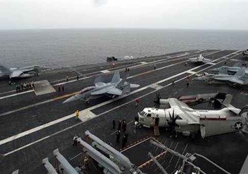 U.S. F18 Hornet fighter attack aircraft prepare to take off from the deck of the U.S. nuclear-powered aircraft carrier, USS George Washington during a military exercise off South Korea's West Sea