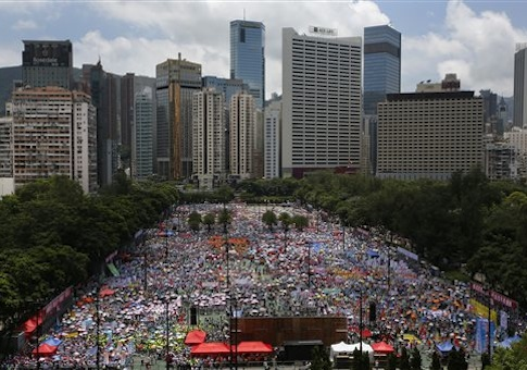 Tens of thousands of people gather at Hong Kong's Victoria park to join a protest march to oppose a planned civil disobedience campaign by pro-democracy activists in Hong Kong