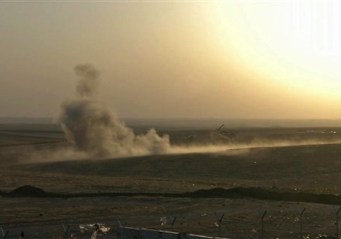 This image made from AP video shows smoke rising from airstrikes targeting Islamic State militants near the Khazer checkpoint outside of the city of Irbil in northern Iraq