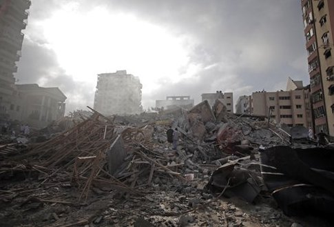Rubble of the Al-Zafer apartment tower following Israeli airstrikes Saturday