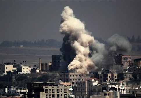 Smoke and sand are seen following what witnesses said was an Israeli air strike in Gaza August 25