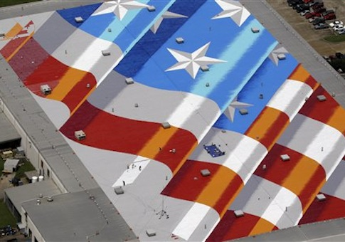 An American flag painted by New York artist Scott LoBaido on top of Lamons Gasket Company