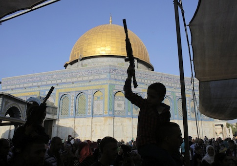 Palestinian children hold toy guns in front of the Dome of the Rock during a protest on the compound known to Muslims as al-Haram al-Sharif and to Jews as Temple Mount in Jerusalem's Old City, against Israel's military offensive in Gaza