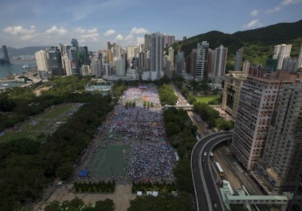 Thousands of pro-Beijing protesters gather to march in the streets to demonstrate against a pro-democracy Occupy Central campaign in Hong Kong