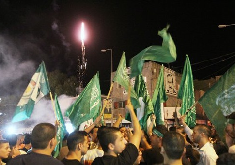 Palestinians celebrate the newly agreed cease-fire between Israel and Gaza