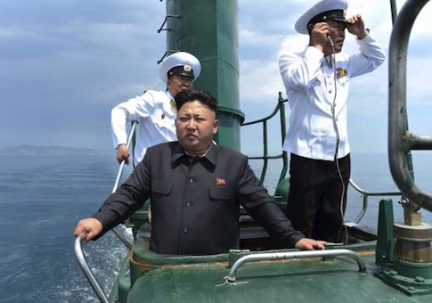 North Korean leader Kim Jong Un stands on the conning tower of a submarine during his inspection of the Korean People's Army Naval Unit 167 in this undated photo released June 16, 2014