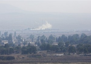 Smoke caused by fighting in Syria is seen from the Israeli-controlled Golan Heights, close to the border with Syria