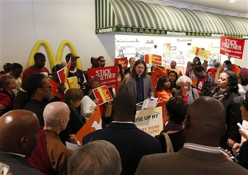 Rally for a higher minimum wage outside a McDonald's restaurant at the Empire State Plaza concourse in Albany, N.Y., in May