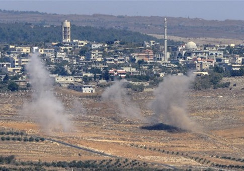 Smoke rises following explosions in Syria, seen from the Israeli-controlled Golan Heights, Tuesday, Sept. 23, 2014. The Israeli military said it shot down a Syrian fighter jet using the Patriot air defense system after the plane infiltrated airspace over the Golan Heights early Tuesday