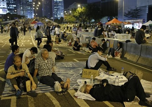 Protesters take a rest during a rally in the occupied areas at Central district in Hong Kong, Thursday, Oct. 9