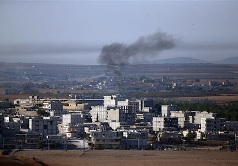 Smoke from a fire rises following a strike in Kobani, Syria