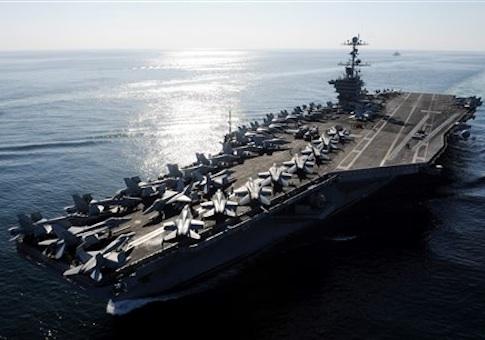 The Nimitz-class aircraft carrier USS John C. Stennis (CVN 74) transits the Straits of Hormuz