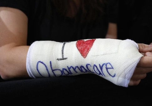 Cathey Park of Cambridge, Massachusetts wears a cast for her broken wrist with ''I Love Obamacare''