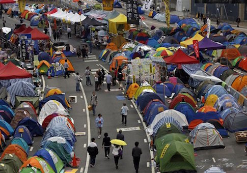 Tents set up by pro-democracy protesters are seen in an occupied area outside government headquarters in Hong Kong's Admiralty district in Hong Kong Tuesday, Nov. 11