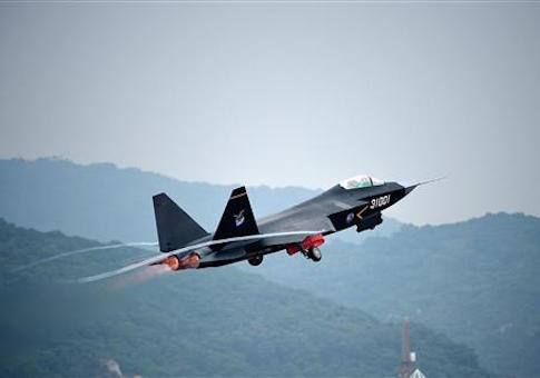 A Chinese J-31 stealth fighter jet takes off for a demonstration flight ahead of the 10th China International Aviation and Aerospace Exhibition, also known as Airshow China 2014, in Zhuhai city