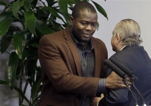 Josephus Weeks is introduced by his attorney during a news conference in Dallas