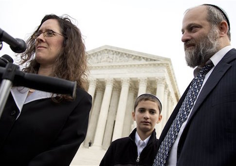 Menachem Zivotofsky, center, stands with his father Ari Zivotofsky, right, and their attorney Alyza Lewin, outside the Supreme Court in Washington, Monday, Nov. 3