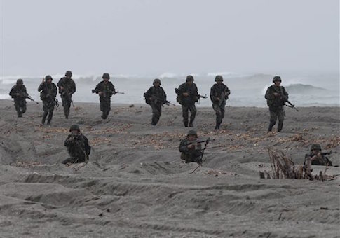 U.S. Marines and their Philippine counterpart secure the perimeter during the 20th Cooperation Afloat Readiness And Training (CARAT), a joint naval exercise