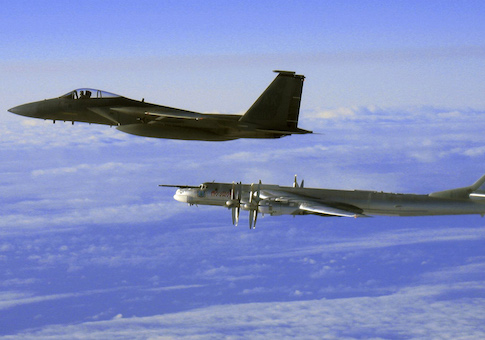 """This Thursday, Sept. 28, 2006 file photo provided by the U.S. Air Force shows an F-15C Eagle from the 12th Fighter Squadron at Elmendorf Air Force Base in Anchorage, Alaska, flying next to a Russian Tu-95 """"Bear"""" bomber, right, during a Russian exercise which brought the bomber near the west coast of Alaska"""