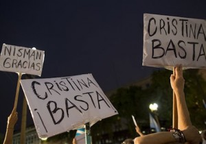 "Protesters hold signs that read in Spanish ""Enough Cristina!"" and ""Thank you Nisman"" outside the government palace in Plaza de Mayo after the death of special prosecutor Alberto Nisman in Buenos Aires, Argentina"