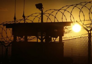 In this photo reviewed by the U.S. military, the sun rises above Camp Delta at Guantanamo Bay Naval Base, Cuba, Wednesday, Nov. 20, 2013