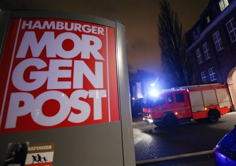 A firef truck sits outside the building of the 'Hamburger Morgenpost'