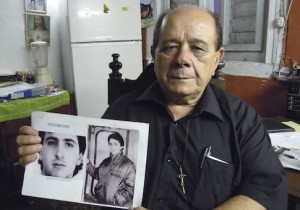 Raul Borges, 74, holds a picture of his son Ernesto Borges in his house in Havana January 2, 2015.