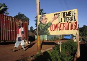 A man walks near a sign with an image of Cuban President Raul Castro in Havana December 19, 2014