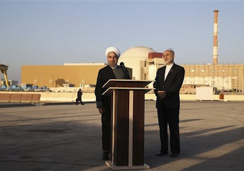 In this photo released by the Iranian Presidency Office, President Hassan Rouhani, left, speaks as he is accompanied by the head of Iran's Atomic Energy Organization Ali Akbar Salehi during his visit to the Bushehr nuclear power plant just outside the port city of Bushehr, southern Iran, Tuesday, Jan. 13