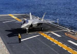 An F-35B Lightning II makes the first vertical landing on a flight deck at sea aboard the amphibious assault ship USS Wasp