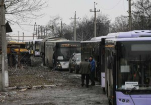 Empty buses, intended for internally displaced persons (IDPs), wait along a road while travelling in the direction of the village of Debaltseve to evacuate the residents, in Vuhlehirsk, Donetsk region February 6, 2015