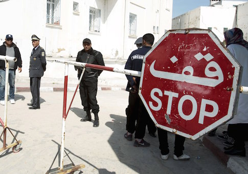 People are pictured near the morgue in Tunis March 19, 2015