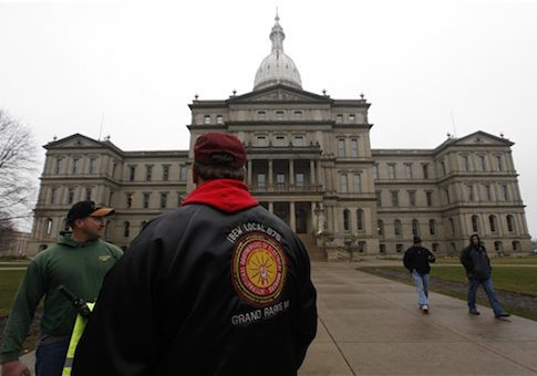 International Brotherhood of Electrical Workers members stand outside the capitol in Lansing, Friday, Dec. 7, 2012
