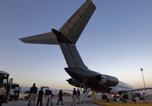 Illegal immigrants from El Salvador are boarded on an MD-80 aircraft for a repatriation flight carrying 80 immigrants to their home country at dawn