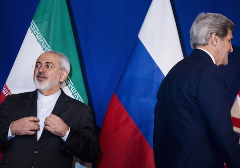 Iranian Foreign Minister Zarif waits to make a statement next to U.S. Secretary of State Kerry following nuclear talks in Lausanne