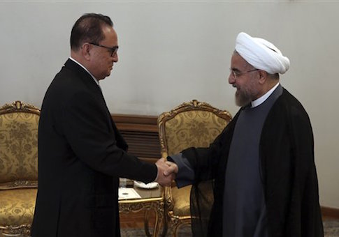 Iranian President Hassan Rouhani, right, welcomes North Korean Foreign Minister Ri Su Yong, for a meeting in Tehran, Iran, Tuesday, Sept. 16, 2014