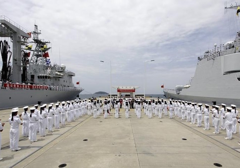 Chinese navy sailors stand in formation as they attend a send-off ceremony before departing for the Rim of the Pacific exercise, at a military port in Sanya