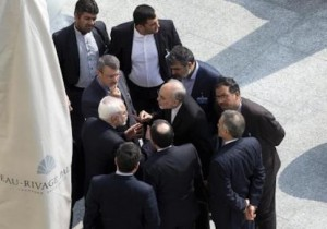 Iran's Foreign Minister Zarif and head of the Atomic Energy Organization of Iran Salehi talk outside with aides after a morning negotiation session with U.S. Secretary of State Kerry in Lausanne