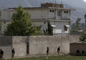 Members of the anti-terrorism squad are seen surrounding the compound where al Qaeda leader Osama bin Laden was killed in Abbottabad