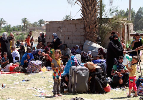 Displaced Sunni people fleeing the violence in the city of Ramadi arrive at the outskirts of Baghdad