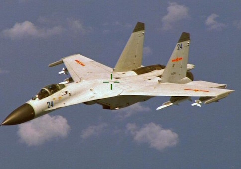 A Chinese J-11 fighter jet is seen flying near a U.S. Navy P-8 Poseidon east of China's Hainan Island