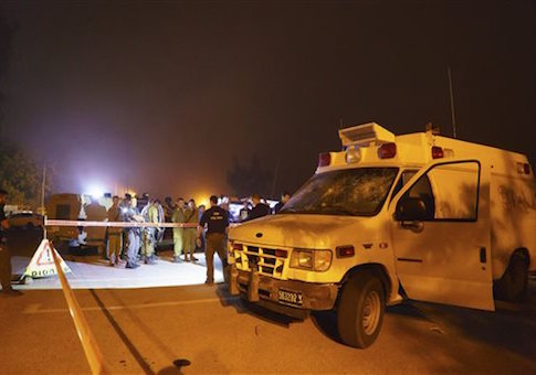 Israeli security forces stand guard around an ambulance which was attacked at the Golan Heights