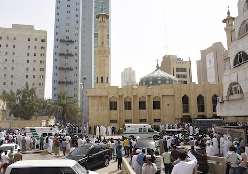 Ambulances park in front of the Imam Sadiq Mosque after a bomb explosion following Friday prayers, in the Al Sawaber area of Kuwait City