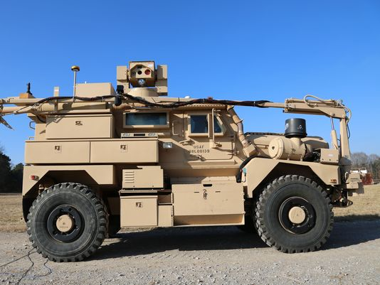 Army Air Force Help Construct Mrap Adorned With Zeus