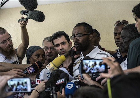 Relatives of Ethiopian-Israeli Avraham Mengistu, 28, hold a press conference in the costal city of Ashkelon, Israel, Thursday, July 9