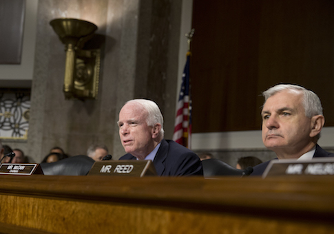 Senate Armed Services Committee Chairman Sen. John McCain, R-Ariz., joined by the committee's ranking member Sen. Jack Reed, speaks during the Senate Armed Services Committee hearing on Capitol Hill in Washington, Tuesday, July 7