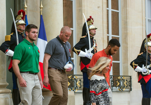 U.S. National Guardsman from Roseburg, Oregon, Alek Skarlatos, left, U.S. Airman Spencer Stone, 2nd left, and Anthony Sadler, right, a senior at Sacramento University in California, leave the Elysee Palace in Paris, France, with U.S. Ambassador to France Jane D. Hartley after being awarded with the French Legion of Honor by French President, Francois Hollande, Monday, Aug. 24, 2015. French President Francois Hollande and a bevy of officials are presenting the Americans with the prestigious Legion of Honor on Monday. The three American travelers say they relied on gut instinct and a close bond forged over years of friendship as they took down a heavily armed man on a passenger train speeding through Belgium. (AP Photo/Kamil Zihnioglu)