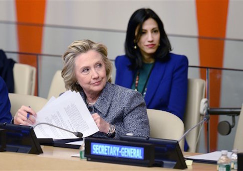 Huma Abedin sits close behind Hillary Clinton