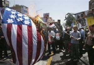 Iranian demonstrators burn a representation of the U.S. flag in an annual pro-Palestinian rally marking Al-Quds (Jerusalem) Day