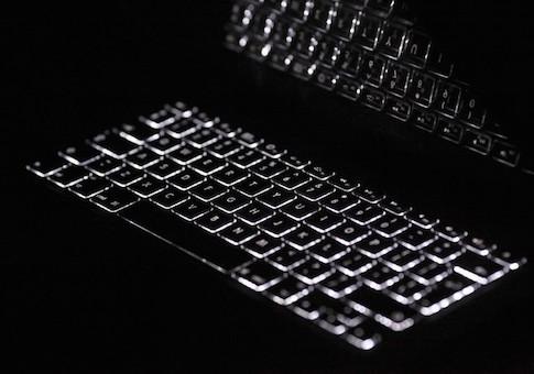 Backlit keyboard is reflected in screen of Apple Macbook Pro notebook computer